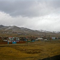 As we continued drifting towards Mongolia's capital, the sun was swallowed by clouds, dunes morphed into frozen, cracked earth, and miniature horses appeared, clinging to the exposed, fruitless plains...