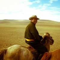 Riding horseback with nomads in Mongolia. Like traveling back to the time of Ghengis Khan, this was a pretty surreal experience. I took a video too, which you can check out here if you like! :)